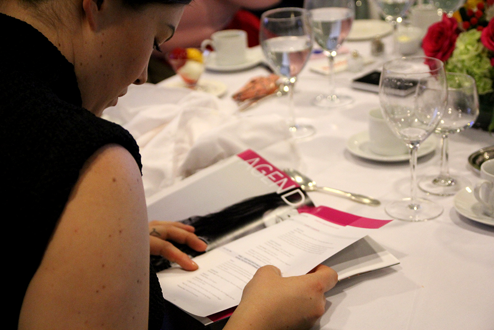 EWNYC 2016 participant reading the Program Book