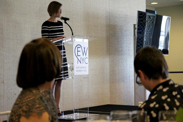 Cindi Leive (at podium) & Linda Heasley and Christian Siriano